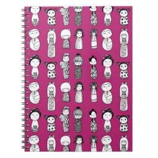 Kokeshi Dolls on Magenta Notebook