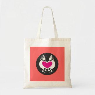 Kokopelli with pink heart tote bag