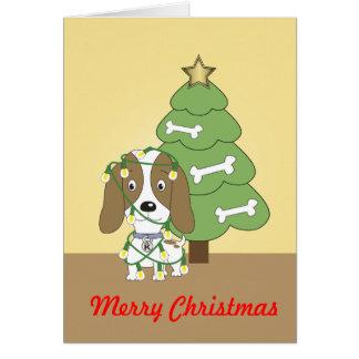 Kosmo the dog decorating his Christmas tree Card