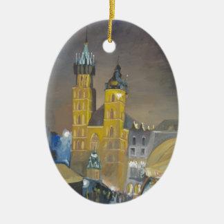Kraków en la noche adorno navideño ovalado de cerámica