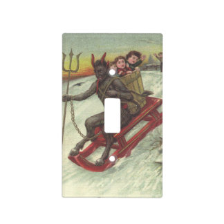 Krampus Kidnapping Kids On Sleigh Pitchfork Switch Plate Covers