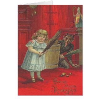 Krampus que juega con el chica tarjeta de felicitación