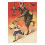 Krampus que persigue al niño tarjetas
