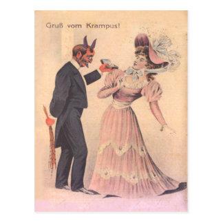 Krampus que propone a la mujer tarjeta postal