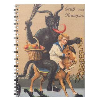 Krampus Riding Hobbyhorse With Boy Notebook