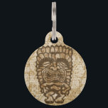 "Ku-Tiki Hawaiian Distressed Hibiscus Pet ID Tag<br><div class=""desc"">Ku, is the god of war. He comes in many shapes and has many expressions. Some fear him, some like to drink with him. This tiki god will add a bit of Hawaiian humor to your life and bring you the spirit of Aloha! Ku is riding on top of a...</div>"