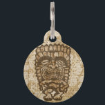 """Ku-Tiki Hawaiian Distressed Hibiscus Pet ID Tag<br><div class=""""desc"""">Ku, is the god of war. He comes in many shapes and has many expressions. Some fear him, some like to drink with him. This tiki god will add a bit of Hawaiian humor to your life and bring you the spirit of Aloha! Ku is riding on top of a...</div>"""