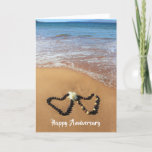 "Kukui Nut Lei Happy Anniversary Card<br><div class=""desc"">Two Kukui Nut leis laying on the beautiful sand of Po'olenalena Beach on Maui, Hawaii! Shaped like hearts with a white double hibiscus with the blue ocean water in the background, this card helps wish any lucky couple a Happy Anniversary! Customize both the front and inside of the card with...</div>"