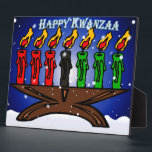 "Kwanzaa Candle Kinara with Snow And Greeting Plaque<br><div class=""desc"">Kwanzaa Candles are a great complement to any home d&#233;cor.  The traditional Red,  Black,  and Green candles set in a brown Kinara,  against a blue background,  with the greeting &#39;Happy Kwanzaa&#39; in ice-blue.  Color scheme is red,  green,  black,  blue,  brown and white.</div>"