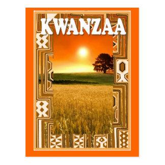 Kwanzaa - puesta del sol y campos de maíz postal