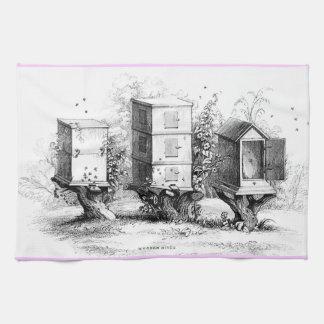 la abeja de madera del vintage encorcha la toalla