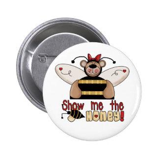 La abeja me muestra las camisetas y los regalos de pins