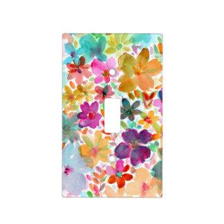La acuarela del arco iris florece la cubierta lige tapas para interruptores