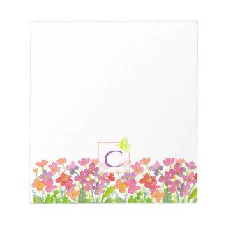 La acuarela rosada florece el monograma verde de blocs de notas