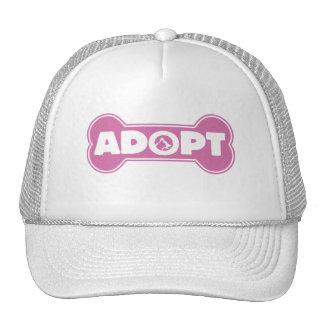 la adopción del gato y del perro adopta el hueso gorros