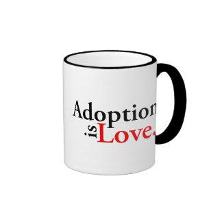La adopción es amor taza de dos colores