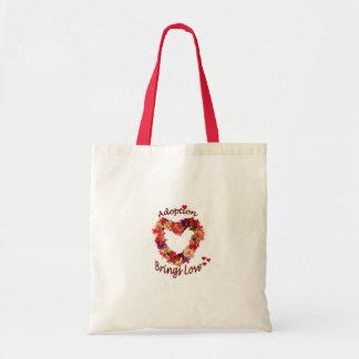 La adopción trae el bolso del amor bolsa