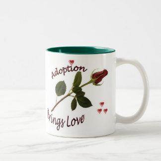 La adopción trae la taza del amor