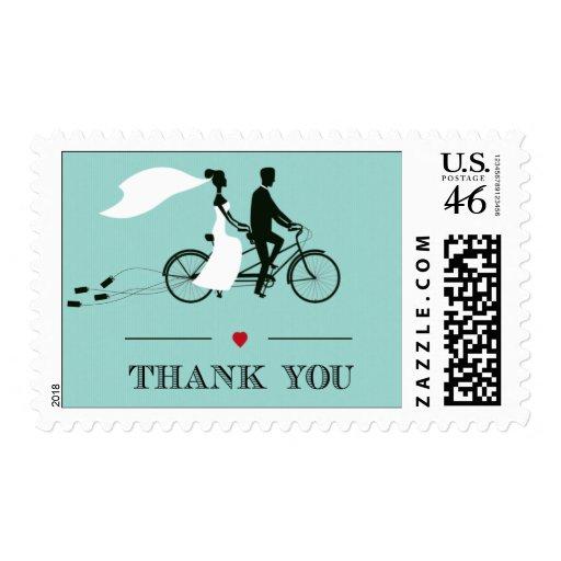 La aguamarina en tándem de la bicicleta le agradec sellos