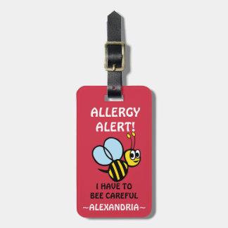 La alarma de la alergia del cacahuete manosea la etiquetas para maletas