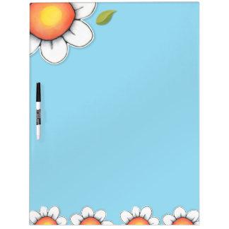 La alegría de la margarita azul seca al tablero de tablero blanco