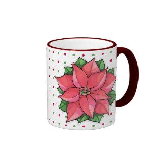 La alegría del Poinsettia puntea la taza