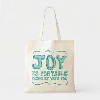 La alegría es bolso portátil en el verde de