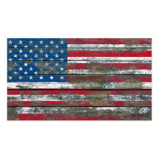 La bandera americana en la madera áspera sube a tarjetas de visita