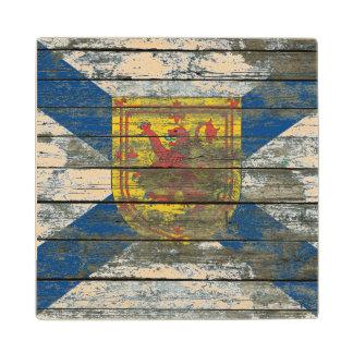 La bandera de Nueva Escocia en la madera áspera Posavasos De Madera