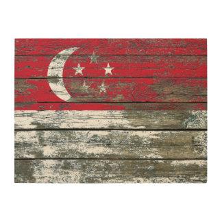 La bandera de Singapur en la madera áspera sube a Cuadro De Madera