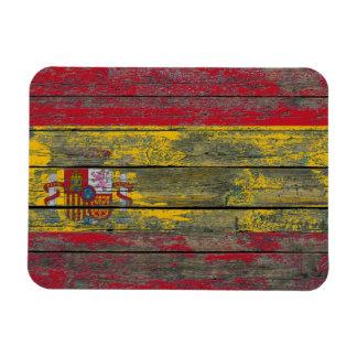 La bandera española en la madera áspera sube a imanes de vinilo