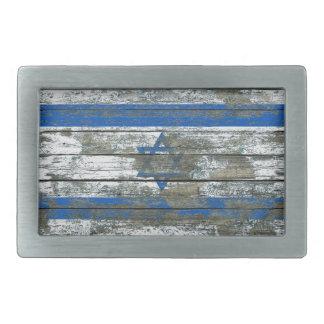 La bandera israelí en la madera áspera sube a hebillas de cinturon rectangulares