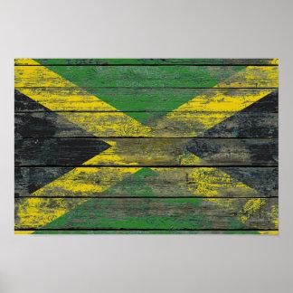 La bandera jamaicana en la madera áspera sube a impresiones