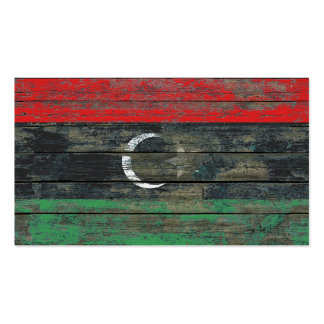 La bandera libia en la madera áspera sube a efecto tarjetas de visita