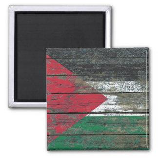 La bandera palestina en la madera áspera sube a imán para frigorífico