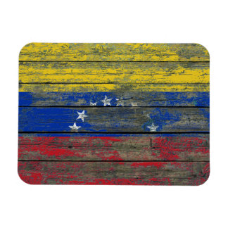 La bandera venezolana en la madera áspera sube a imán flexible