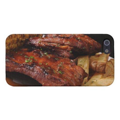 La barbacoa asada a la parrilla fuego provee de co iPhone 5 protectores