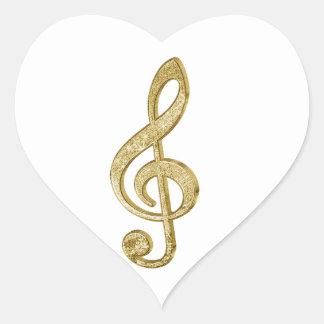 La barra de oro brillante impresionante efectúa pegatina en forma de corazón