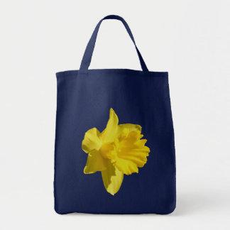 La bolsa de asas amarilla de la foto de la flor de