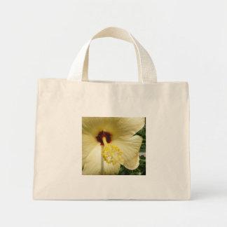 La bolsa de asas amarilla del hibisco