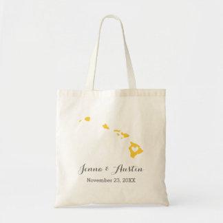 La bolsa de asas amarilla y gris de la recepción d