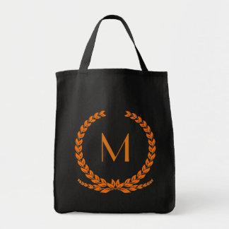 La bolsa de asas anaranjada adaptable de la hoja