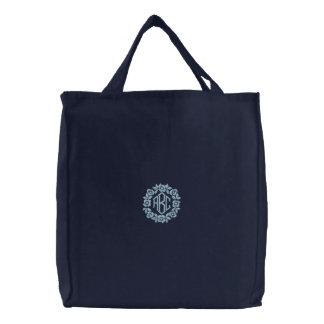 La bolsa de asas azul clara del monograma de las f