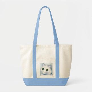 La bolsa de asas blanca bonita del gatito