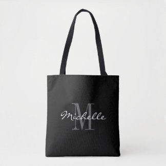 La bolsa de asas blanco y negro atractiva del