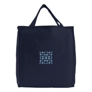 La bolsa de asas bordada cuadrado azul de la lona
