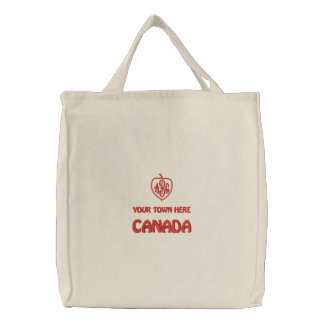 La bolsa de asas bordada del monograma de CANADÁ
