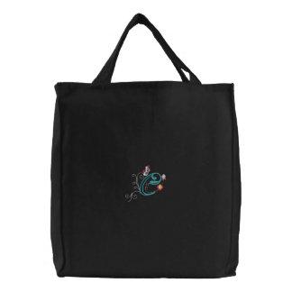La bolsa de asas bordada mariposa floral del monog