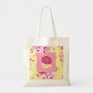 La bolsa de asas color de rosa rosada