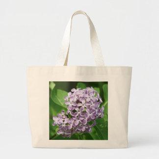 la bolsa de asas con la foto de lilas púrpuras